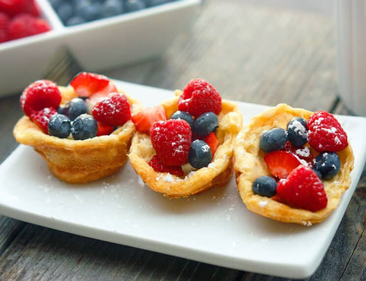 3 mini puff pancakes with blueberries and straberries