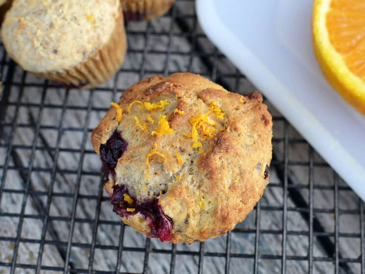 Top down view of a whole wheat blueberry orange muffin
