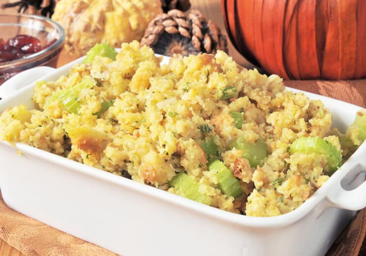 A baking dish of crockpot stuffing with celery and turkey bits