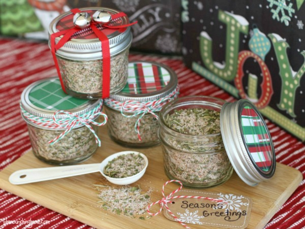Small glass jars filled with seasoning mixes topped with colorful lids