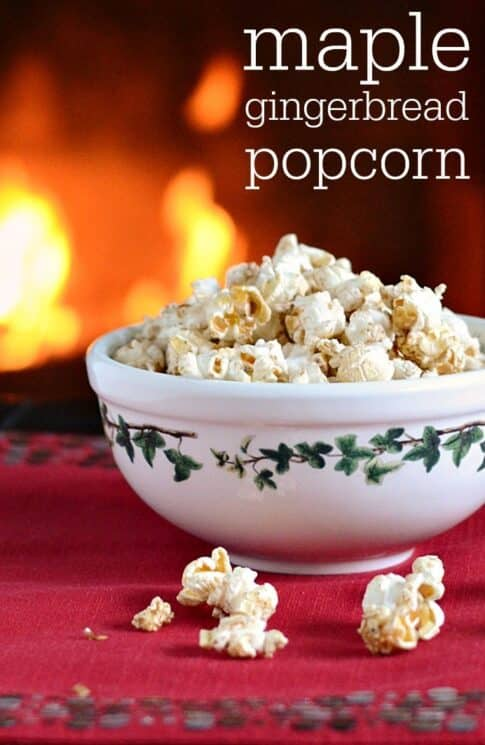 Popcorn in a holiday bowl in front of a fireplace