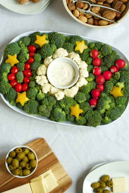 Veggies that spell out the word joy with a dip bowl as the o