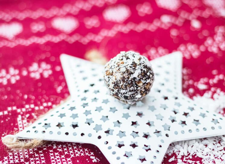 no bake coconut snowball sitting on a white christmas ornament star
