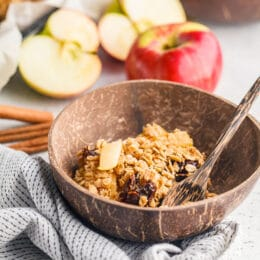 Apple cinnamon baked oatmeal in a wooden bowl