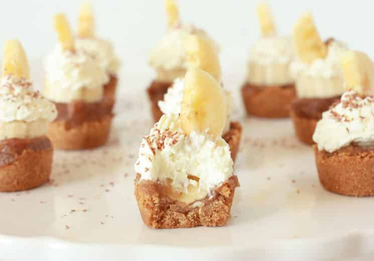 Banoffee Pie Bites with a bite removed showing the whip cream and the banana slice