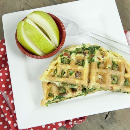 waffle with spinach and bacon served with pears on the side