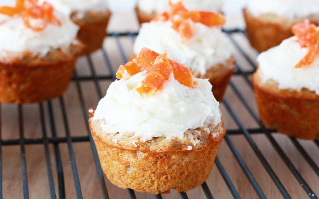 Close up of a carrot cake muffin on a refrigerated shelf