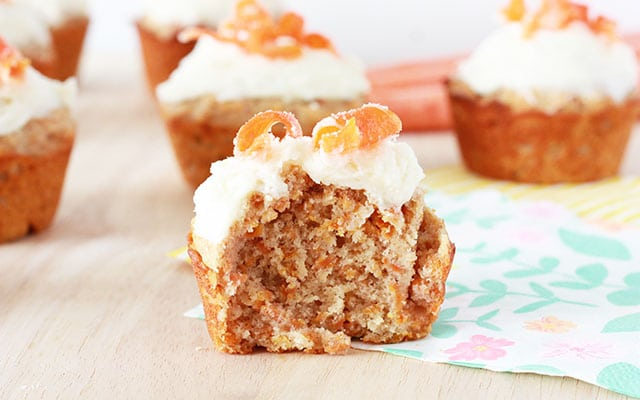 closeup of a carrot cake muffin with a bite taken out
