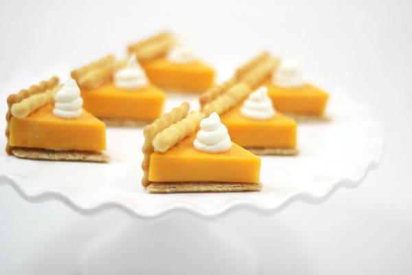 cheese cut into triangles to resemble pie with a cream cheese dab to look like whipped cream