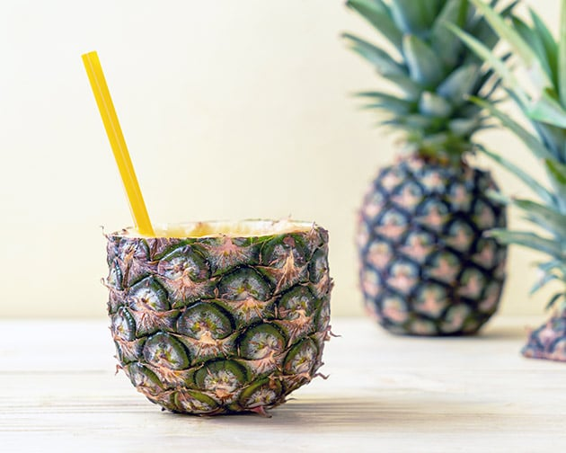 pineapple cooler inside of a pineapple with a straw