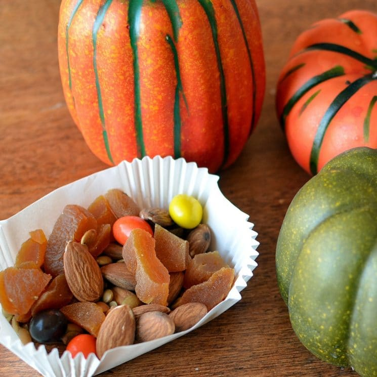 festive fall trail mix with almonds, apricots, and candies