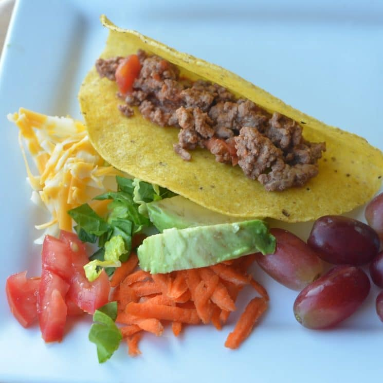tacos with meat and fruits and veggies
