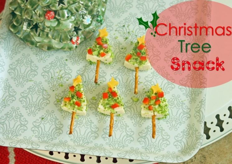 Triangle shaped tree topped with veggie ornaments on a holiday plate