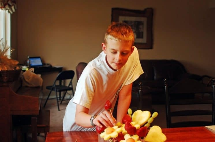 child eating fruit bouquet.jpg