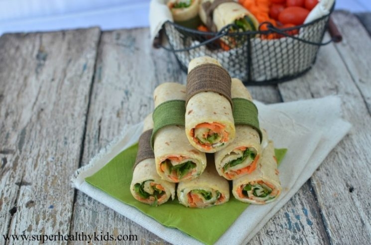 Veggie Lunch Wraps. Need a new lunch idea? We love this veggie wrap! They hold together so well without all the fillings coming out!