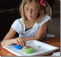girl eating chip dip