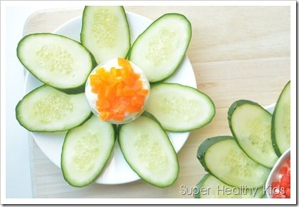 Cucumber flowers with pepper yogurt cheese spread. Strained yogurt makes a high protein dip, perfect for veggies like cucumbers!